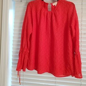 Michael Kors ladies blouse is size XL